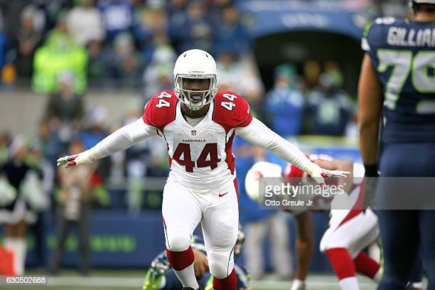 Linebacker Markus Golden of the Arizona Cardinals celebrates after a play against the Seattle Seahawks at CenturyLink Field on December 24 2016 in...