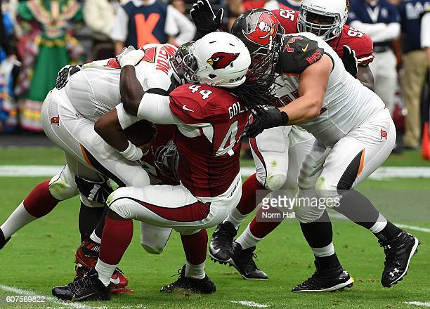 Linebacker Markus Golden of the Arizona Cardinals tackles quarterback Jameis Winston of the Tampa Bay Buccaneers during the second quarter of the NFL...