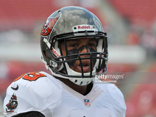 Linebacker Mason Foster of the Tampa Bay Buccaneers warms up for play against the Philadelphia Eagles October 13, 2013 at Raymond James Stadium in...