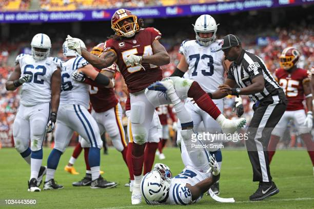 Linebacker Mason Foster of the Washington Redskins celebrates after tackling running back Marlon Mack of the Indianapolis Colts during the first...