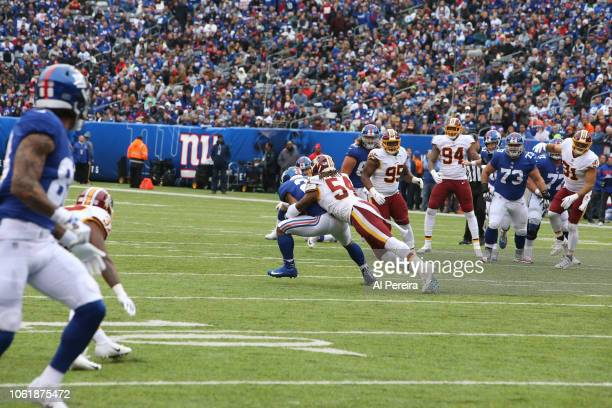 Linebacker Mason Foster of the Washington Redskins in action against the New York Giants during their game at MetLife Stadium on October 28, 2018 in...