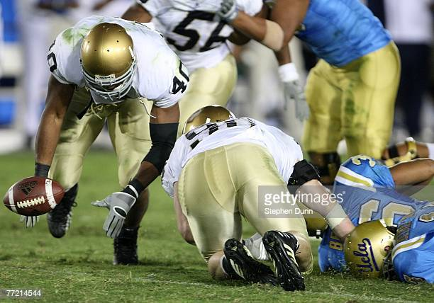 Linebacker Maurice Crum of the Notre Dame Fighting Irish recovers a fumble before returning it for a touchdown against the UCLA Bruins at the Rose...
