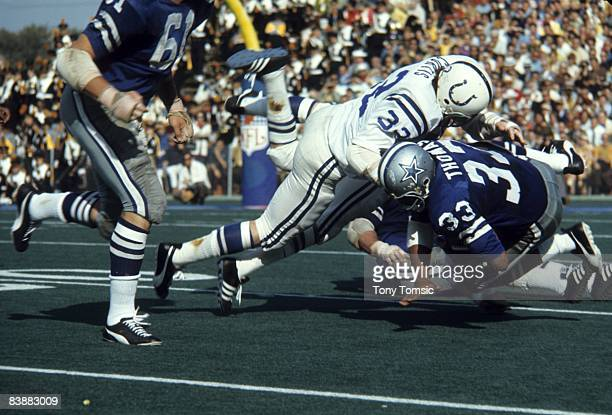 Linebacker Mike Curtis of the Baltimore Colts stops runningback Duane Thomas of the Dallas Cowboys during Super Bowl V on January 17 1971 at the...