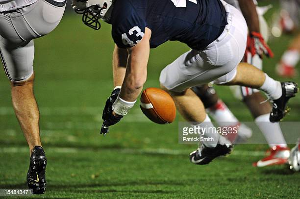 Linebacker Mike Hull of the Penn State Nittany Lions blocks an Ohio State Buckeyes punt in the second quarter that led to a touchdown at Beaver...