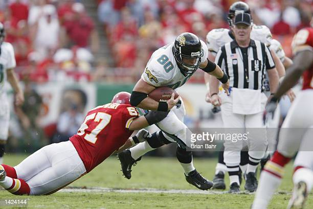 Linebacker Mike Maslowski of the Kansas City Chiefs tackles tight end Kyle Brady of the Jacksonville Jaguars during the NFL game on September 15 at...