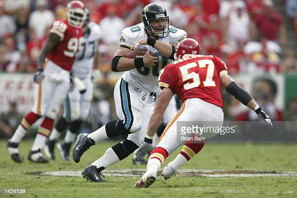 Linebacker Mike Maslowski of the Kansas City Chiefs tries to tackle tight end Kyle Brady of the Jacksonville Jaguars during the NFL game on September...