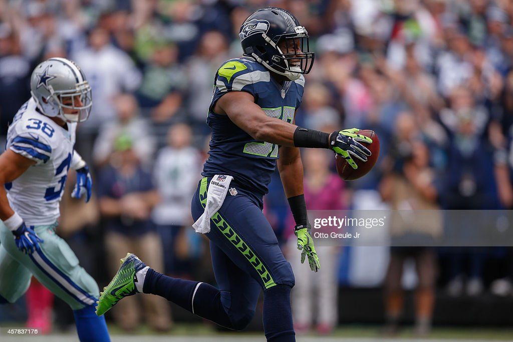 Linebacker Mike Morgan #57 of the Seattle Seahawks retunes a blocked punt for a touchdown against the Dallas Cowboys at CenturyLink Field on October 12, 2014 in Seattle, Washington.