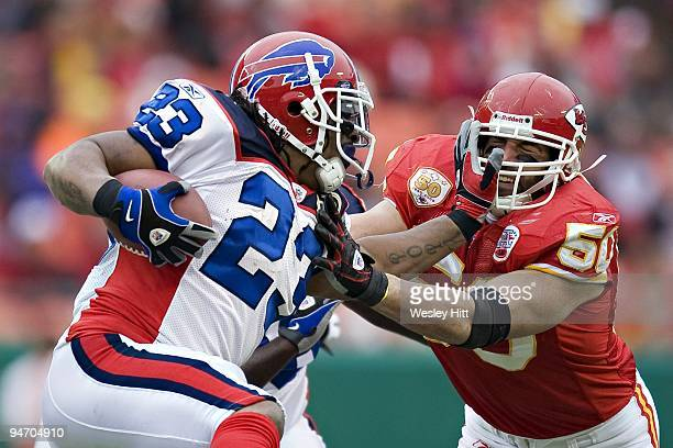 Linebacker Mike Vrabel of the Kansas City Chiefs tries to tackle running back Marshawn Lynch of the Buffalo Bills at Arrowhead Stadium on December 13...