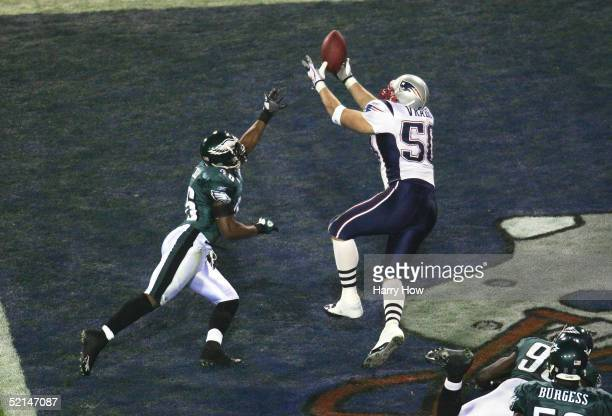 Linebacker Mike Vrabel of the New England Patriots catches a two yard touchdown in the third quarter against cornerback Lito Sheppard of the...
