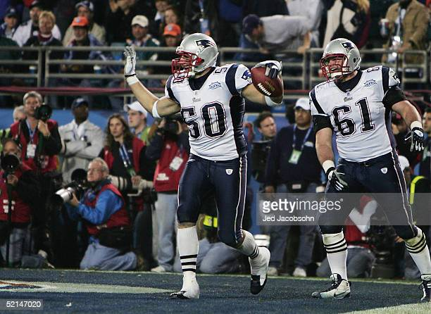 Linebacker Mike Vrabel of the New England Patriots celebrates with teammate Stephen Neal after catching a 2yard touchdown pass against the...
