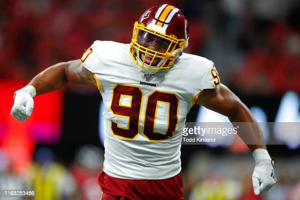 Linebacker Montez Sweat of the Washington Redskins reacts after a sack in the first half of an NFL preseason game against the Atlanta Falcons at...