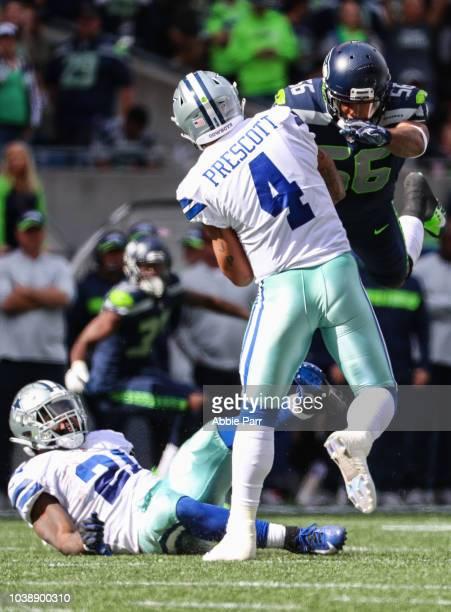 Linebacker Mychal Kendricks of the Seattle Seahawks dives at quarterback Dak Prescott of the Dallas Cowboys at CenturyLink Field on September 23 2018...