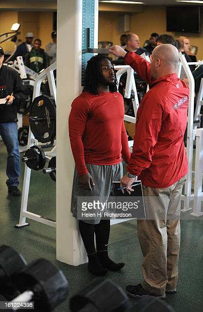 CSU linebacker Mychal Sisson gets his height checked by a scout Scouts from 9 NFL teams turned out at Colorado State University's indoor football...