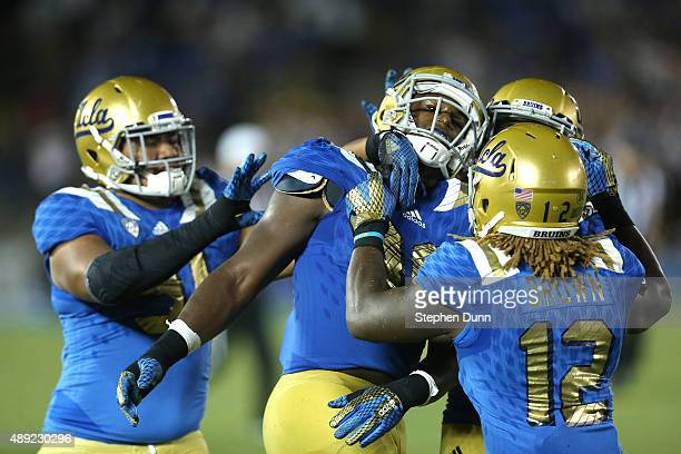 Linebacker Myles Jack of the UCLA Bruins is mobbed by Jayon Brown and Jacob TuiotiMarniner after his fourth down interception ended the final drive...