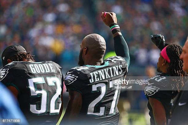Linebacker Najee Goode of the Philadelphia Eagles and teammates strong safety Malcolm Jenkins and cornerback Ron Brooks are shown during the national...