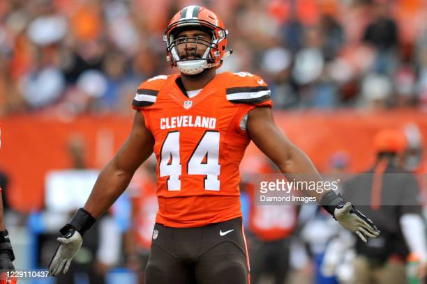 Linebacker Nate Orchard of the Cleveland Browns gestures toward the crowd in the second quarter of a game against the San Francisco 49ers at...