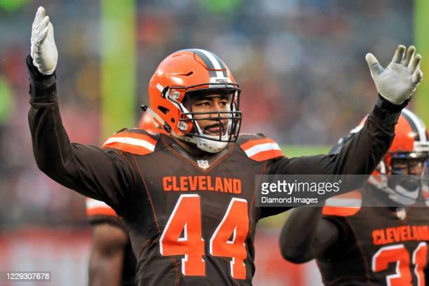 Linebacker Nate Orchard of the Cleveland Browns gestures toward the crowd in the third quarter of a game against the Pittsburgh Steelers at...