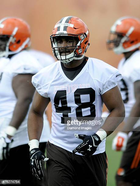 Linebacker Nate Orchard of the Cleveland Browns runs onto the field during a mini camp practice on May 26, 2015 at the Cleveland Browns Training...
