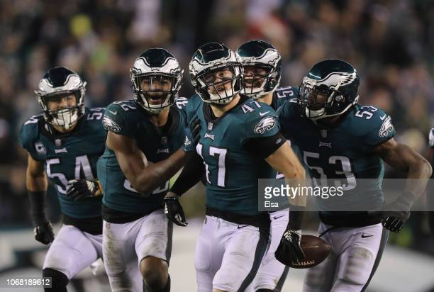 Linebacker Nathan Gerry of the Philadelphia Eagles celebrates intercepting a pass against quarterback Mark Sanchez of the Washington Redskins during...
