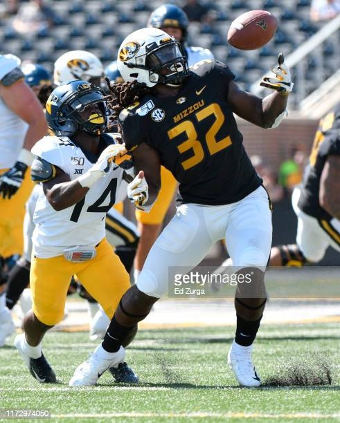 Linebacker Nick Bolton of the Missouri Tigers intercepts a pass intended for wide receiver Tevin Bush of the West Virginia Mountaineers in the first...