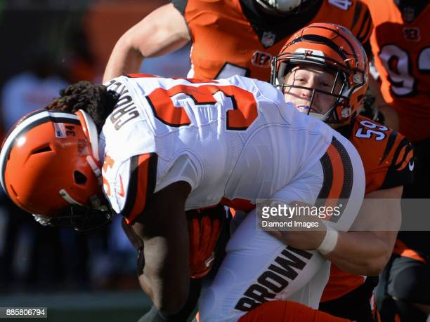 Linebacker Nick Vigil of the Cincinnati Bengals tackles running back Isaiah Crowell of the Cleveland Browns in the first quarter of a game on...