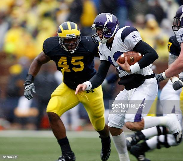 Linebacker Obi Ezeh of the Michigan Wolverines gets ready to make the stop on quarterback C. J. Bacher of the Northwestern Wildcats in the first...