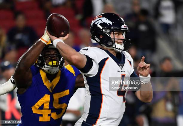 Linebacker Obo Okoronkwo of the Los Angeles Rams deflects a pass by Quarterback Brett Rypien of the Denver Broncos for an incompletion during the...