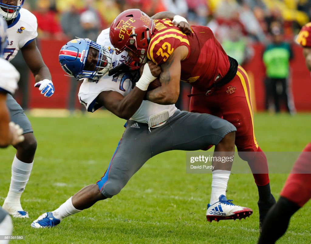 Linebacker Osaze Ogbebor #31 of the Kansas Jayhawks tackles running back David Montgomery #32 of the Iowa State Cyclones as he rushed for yards in the second half of play at Jack Trice Stadium on October 14, 2017 in Ames, Iowa. The Iowa State Cyclones won 45-0 over the Kansas Jayhawks.
