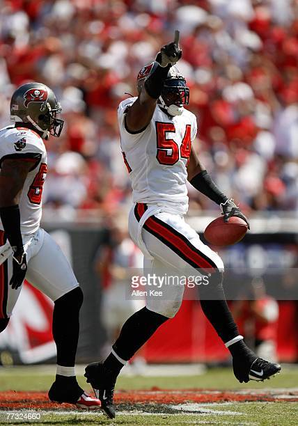 Linebacker Patrick Chukwurah of the Tampa Bay Buccaneers celebrates a play against the Tennessee Titans at Raymond James Stadium on October 14 2007...