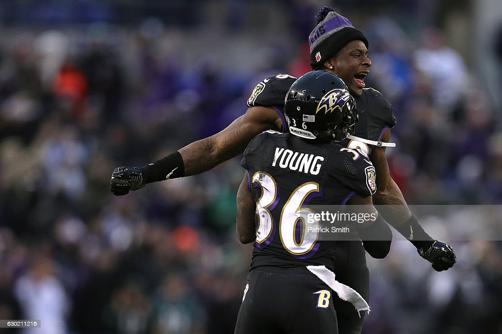 Linebacker Patrick Onwuasor #48 of the Baltimore Ravens cekebrates with teammate cornerback Tavon Young #36 after the Baltimore Ravens defeated the Philadelphia Eagles 27-26 at M&T Bank Stadium on December 18, 2016 in Baltimore, Maryland.