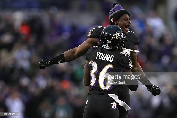 Linebacker Patrick Onwuasor of the Baltimore Ravens cekebrates with teammate cornerback Tavon Young after the Baltimore Ravens defeated the...