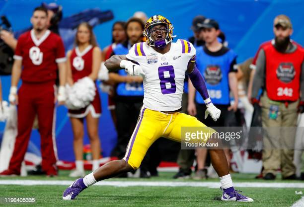 Linebacker Patrick Queen of the LSU Tigers celebrates a defensive play against the Oklahoma Sooners during the ChickfilA Peach Bowl at MercedesBenz...