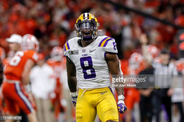 Linebacker Patrick Queen of the LSU Tigers celebrates after making a tackle during the College Football Playoff National Championship game against...