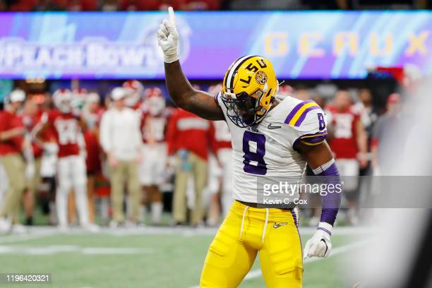 Linebacker Patrick Queen of the LSU Tigers celebrates after sacking linebacker Kenneth Murray of the Oklahoma Sooners during the ChickfilA Peach Bowl...