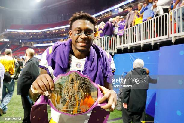 Linebacker Patrick Queen of the LSU Tigers poses with a faux championship belt after winning the ChickfilA Peach Bowl 2863 over the Oklahoma Sooners...