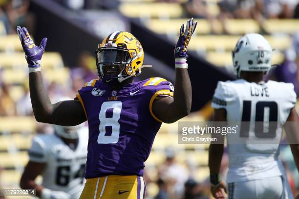 Linebacker Patrick Queen of the LSU Tigers reacts during the game against the Utah State Aggies at Tiger Stadium on October 05 2019 in Baton Rouge...