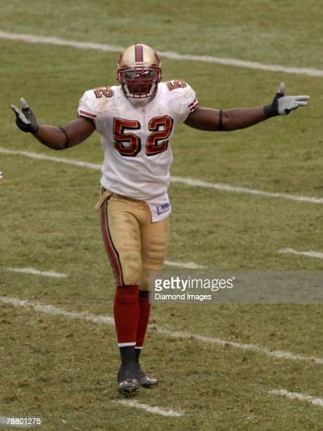 Linebacker Patrick Willis of the San Francisco 49ers gestures towards the officials after a pass interference penalty was called against Willis...