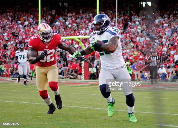 Linebacker Patrick Willis of the San Francisco 49ers pursues fullback Michael Robinson of the Seattle Seahawks on a 12yard catch and run in the first...