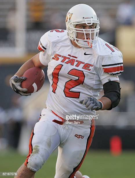Linebacker Paul Duren of the Oklahoma State Cowboys runs upfield against the Colorado Buffaloes on October 9, 2004 at Folsom Field in Boulder,...
