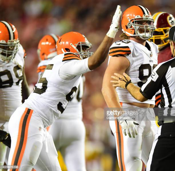 Linebacker Paul Kruger of the Cleveland Browns is congratulated by defensive tackle Armonty Bryant after a sack during a game against the Washington...