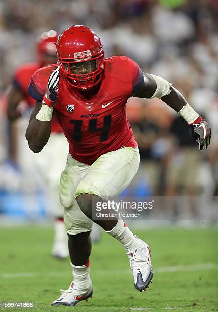 Linebacker Paul Magloire Jr #14 of the Arizona Wildcats in action during the college football game against the Brigham Young Cougars at University of...