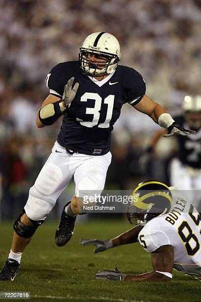 Linebacker Paul Posluszny of the Penn State Nittany Lions looks to make a tackle against the University of Michigan Wolverines at Beaver Stadium on...
