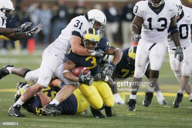Linebacker Paul Posluszny of the Penn State Nittany Lions tackles running back Kevin Grady of the Michigan Wolverines at Michigan Stadium on October...