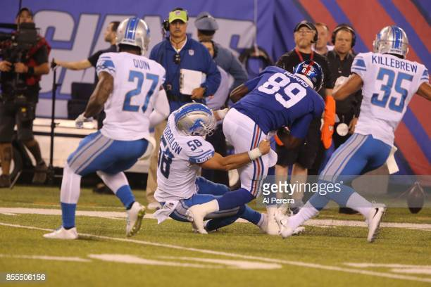 Linebacker Paul Worrilow and Safety Miles Killebrew of the Detroit Lions make a stop against the New York Giants on September 18, 2017 at MetLife...
