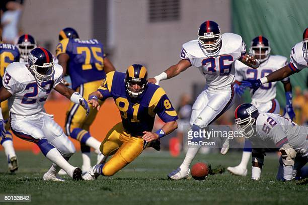 Linebacker Pepper Johnson safety Adrian Wilson and cornerback Perry Williams of the New York Giants and tight end Pete Holohan of the Los Angeles...