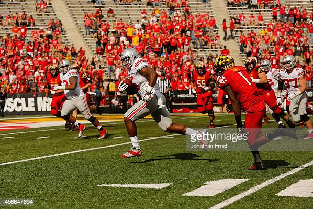 Linebacker Raekwon McMillan of the Ohio State Buckeyes runs back an interception for a touchdown during the fourth quarter of a 5224 Buckeyes win...