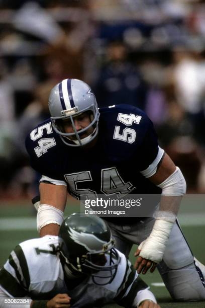 Linebacker Randy White, of the Dallas Cowboys, stands up after sacking quarterback Ron Jaworski, of the Philadelphia Eagles during a game on November...