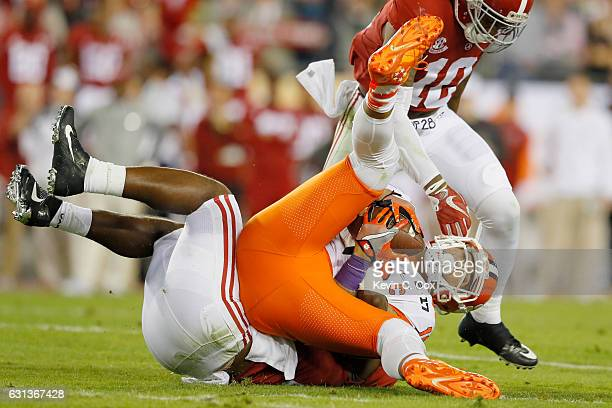 Linebacker Rashaan Evans of the Alabama Crimson Tide tackles tight end Jordan Leggett of the Clemson Tigers during the first half of the 2017 College...