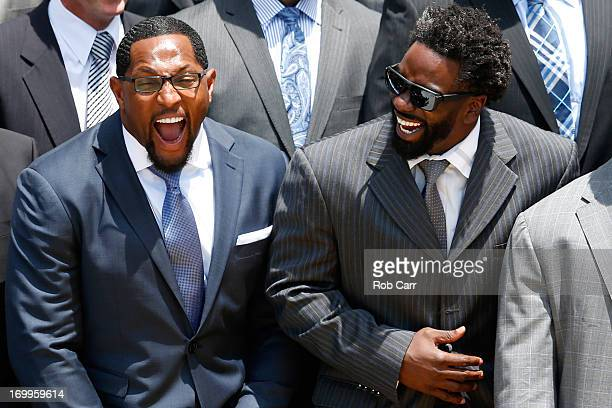 Linebacker Ray Lewis and safety Ed Reed of the National Football League Super Bowl champion Baltimore Ravens laugh while listening to US President...