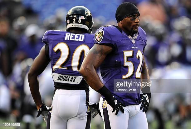 Linebacker Ray Lewis of the Baltimore Ravens and teammate safety Ed Reed of the Baltimore Ravens stand on the field before playing the Jacksonville...
